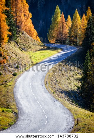 country road at the alps - stock photo