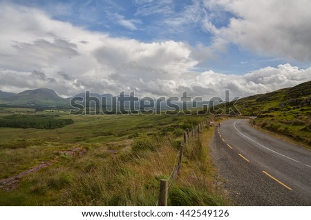 Country road in Iveragh peninsula to follow the famous Ring of Kerry, Ireland