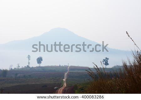 country road in Thailand - stock photo