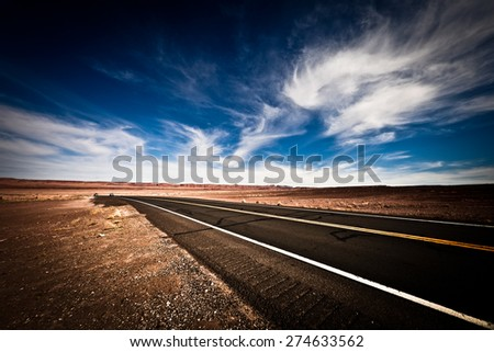 Country Road in the Desert - stock photo