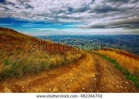 Country road in the mountains. road leading down