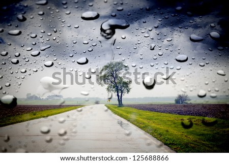 Country Road in the rain - stock photo