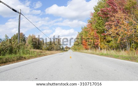 Country road in Vermont, New England. Autumn landscape - stock photo
