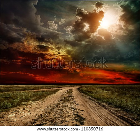 country road leading to the church - stock photo