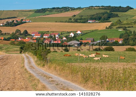 Country Road through a Rural area in France, Europe - stock photo