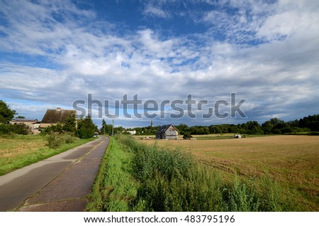 Country road under a cloudy sky