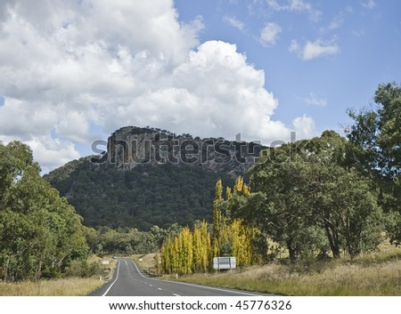 Country road under blue sky, Queensland, Australia - stock photo
