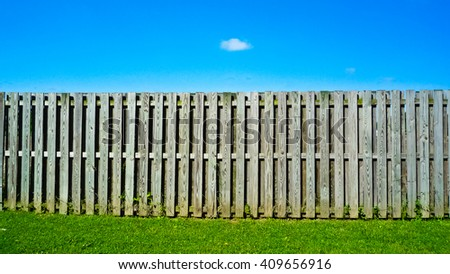 Country scenery with brown fence in the summer