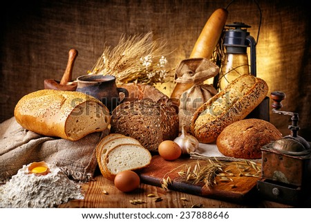 Country still life with bread, cheese, mushrooms and wine in an antique jar - stock photo