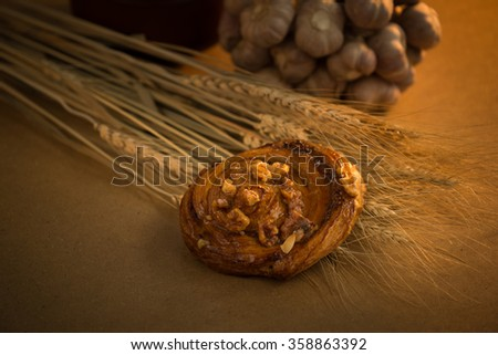 Country still life with bread, garlic and wine in an antique jar