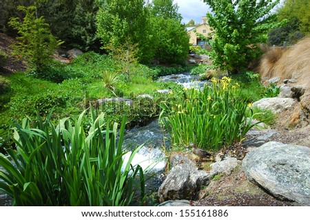 country stream and small home - stock photo