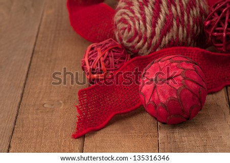Country Style, Folk Art Natural Fiber Christmas Ornaments on Rustic Wood with Copyspace in Horizontal Closeup - stock photo