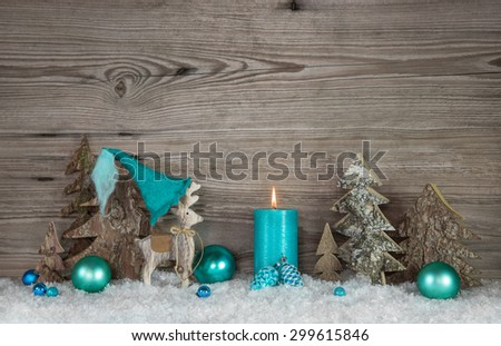 Country style greeting card for christmas with candle and reindeer in turquoise and brown colors. - stock photo