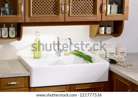 country-style kitchen sink - stock photo
