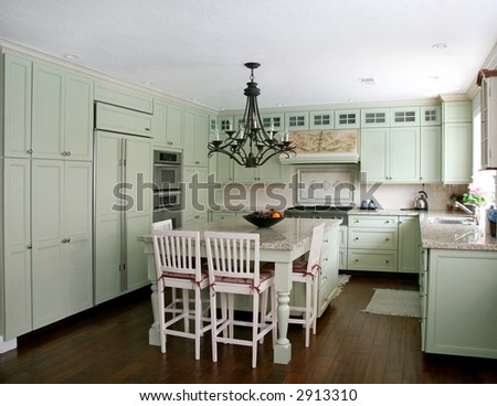 Country style pistachio  kitchen with island - stock photo