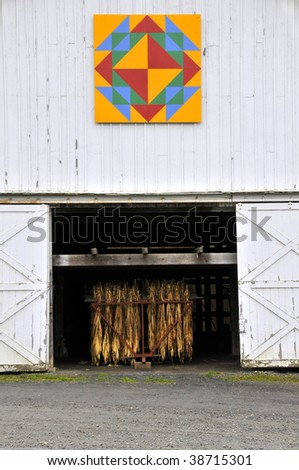 Country Tobacco Barn With Barn Quilt Vertical - stock photo