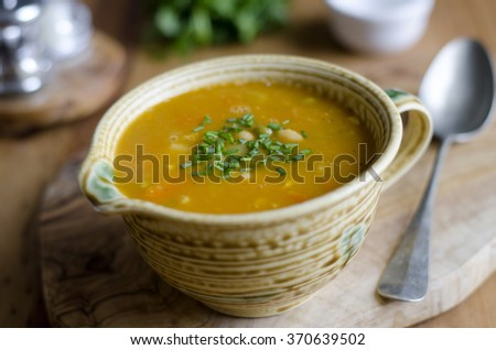 Country vegetable soup topped with chopped chives - stock photo