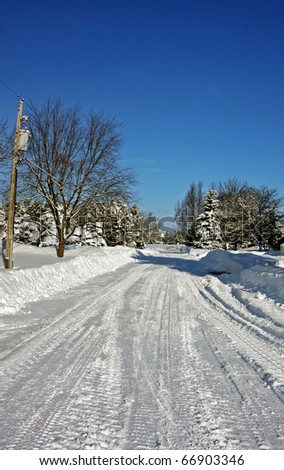 Country winter scene on a sunny day - stock photo