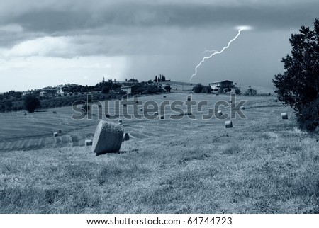 countryside and bad weather on the horizon - stock photo
