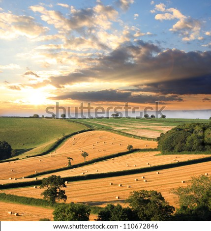 Countryside in England with straw bales, Devon country - stock photo