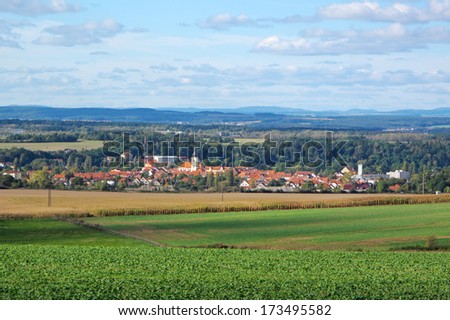 Countryside landscape with small town in valley. Dobrany city, west Bohemia, Czech republic, Eu. - stock photo