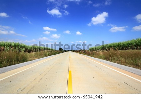 countryside road and beautiful sky - stock photo