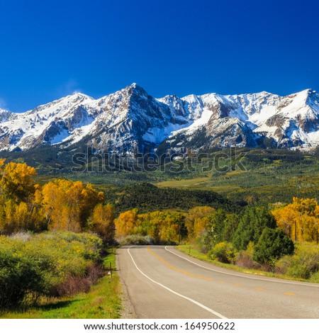 Countryside road, fall season in Colorado - stock photo