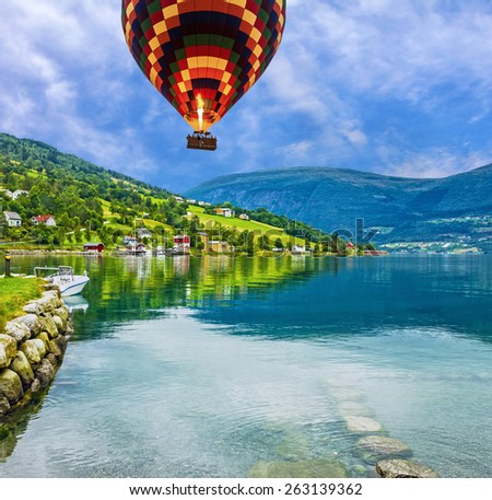 Countryside seascape, Olden, Norway. Hot air balloon