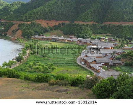 Countryside view, houses and mountains, Yunnan province, China - stock photo