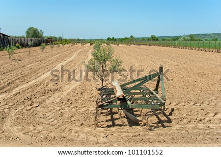 Countryside View of Furrowed Farmland with prairie breaker - stock photo
