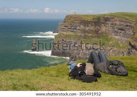 County Clare, Ireland - August 11, 2015: Ireland's 2nd most famous tourist attraction. Cliffs of Moher. On the Wild Atlantic Way, the worlds longest coastal touring route. - stock photo
