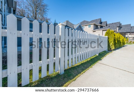 County style wooden fence separate and protect private property.  - stock photo