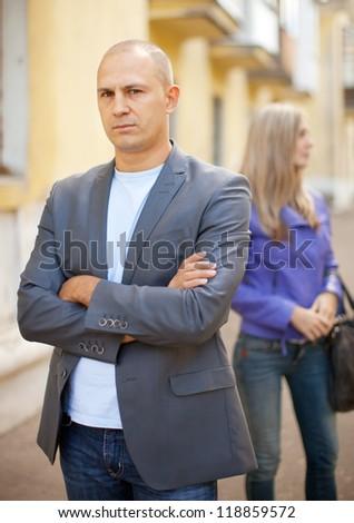 couple after quarrel at city street - stock photo