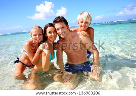 Couple and children in crystal clear water
