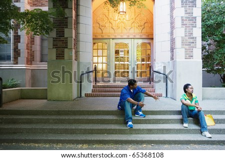 Couple arguing on steps - stock photo