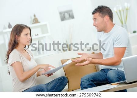 Couple arguing over bills - stock photo