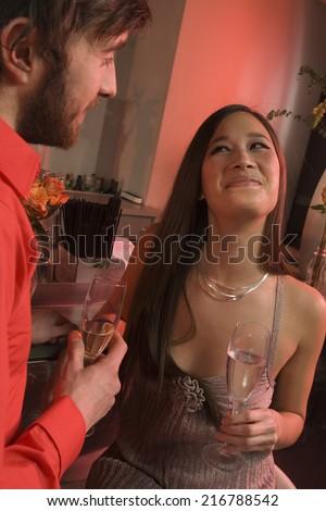 Couple at a nightclub. - stock photo