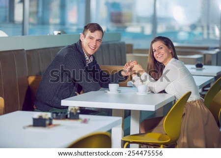 Couple at cafe holding hands, selective focus - stock photo
