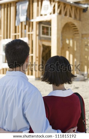 Couple at construction site - stock photo
