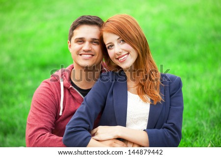 Couple at green grass. - stock photo