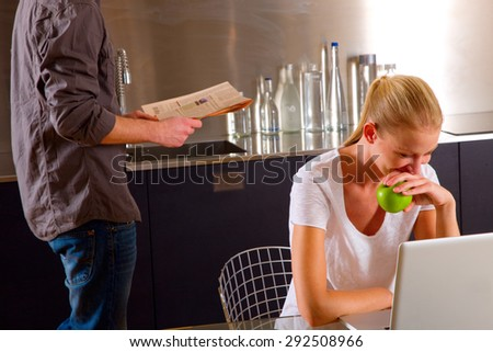 couple at home woman using laptop - stock photo