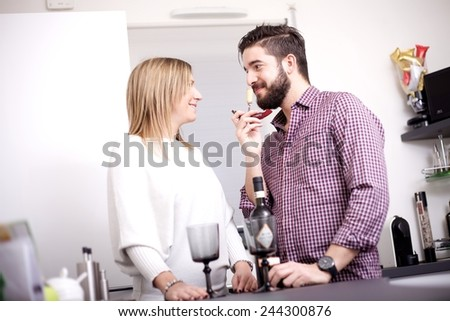 couple at kitchen - stock photo