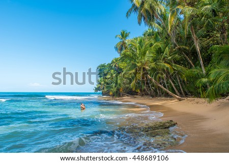 Couple at Paradise wild beach of Manzanillo Park in Costa Rica
