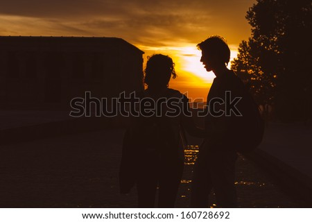 Couple at Sunset in Temple of Debod, Madrid - stock photo