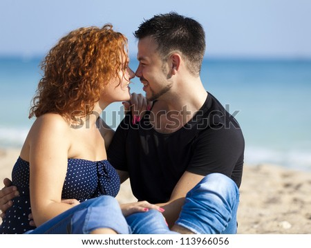 Couple at the beach. - stock photo