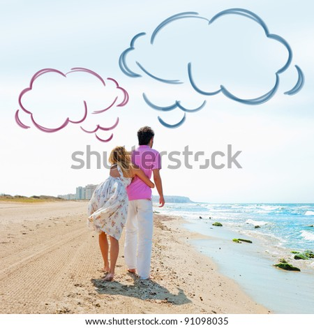Couple at the beach holding hands and walking. Sunny day, bright colors. Europe, Spain, Costa Blanca. Blank cloud balloon overhead - stock photo