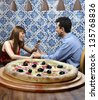 Couple at the pizzeria - stock photo