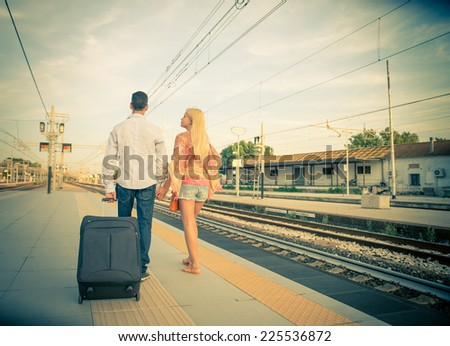 Couple at train station - Last goodbye before the train arrives - stock photo