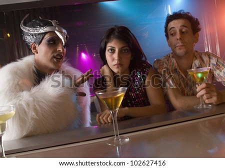 Couple being bothered by person at bar