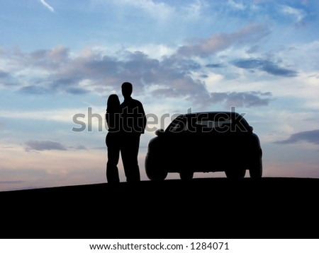 Couple beside the car (silhouette).